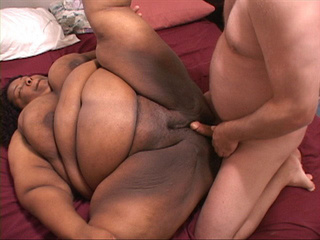 Slutty black fatty is happy to suck a white cock before - Picture 4