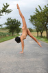 Naked acrobat teen on the road