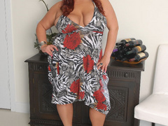 Plump red MILF riding a stiff rod - Picture 1