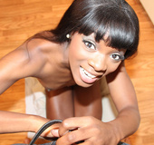 Dark-skinned girl giving a handjob