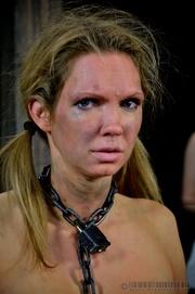 pigtailed blonde slave gets
