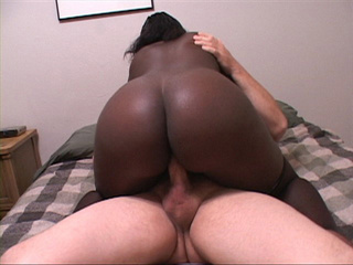 Naughty black vixen in stockings likes riding white - Picture 2
