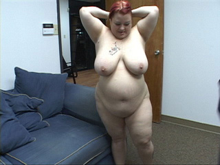 Dirty red fatso opens her back door for a cock - Picture 1