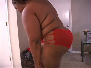 Ebony fat mom sucking a boner - Picture 1