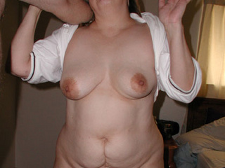 Curly mature in white blouse with hairy pussy - Picture 1