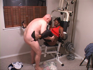 Chubby black mom in a red top spreads her legs - Picture 3
