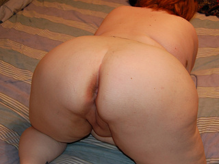 Ponytailed red fatty posing - Picture 1