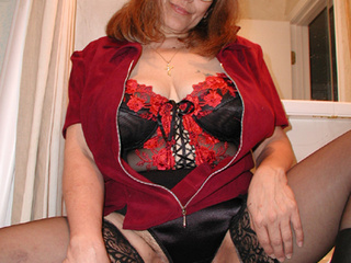 Red granny in glasses and stockings shows off her - Picture 2