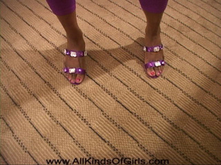 Ponytailed ebony mama in purple leggings showing off - Picture 3