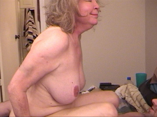 Old slut with blonde hair jumps on stiff rod - Picture 1