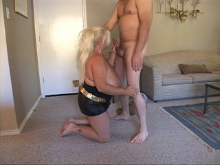 Busty ponytailed blonde sucking man's meat - Picture 1