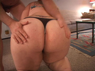 Tattooed ponytailed fat chick gives head kneeling - Picture 2