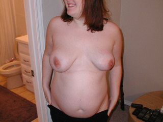 Fat bitch in glasses undresses - Picture 1