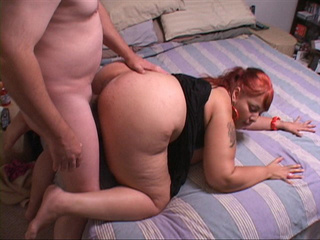 Red ponytailed latina fatty in black dress sucking cock - Picture 2