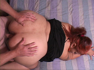 Red ponytailed latina fatty in black dress sucking cock - Picture 4
