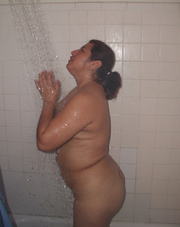 chubby ponytailed housewife taking