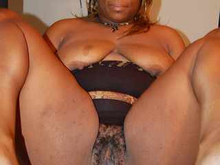 Busty black mature with hairy twat shows it off - Picture 4