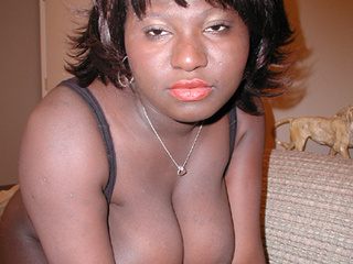 Busty black mom takes white boner into her twat - Picture 1
