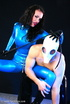 Sexy acrobatic couple posing in latex