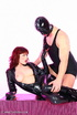 Young couple in black latex posing with each other before sex