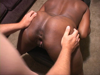 Black ebony bends low on small leather stool to get her - Picture 2