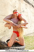 Young couple in underwear performs acrobatic show