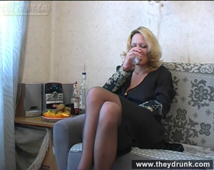 Lonely blond milf relaxing with alcohol then getting naked and playing with her hot pussy - XXXonXXX - Pic 1