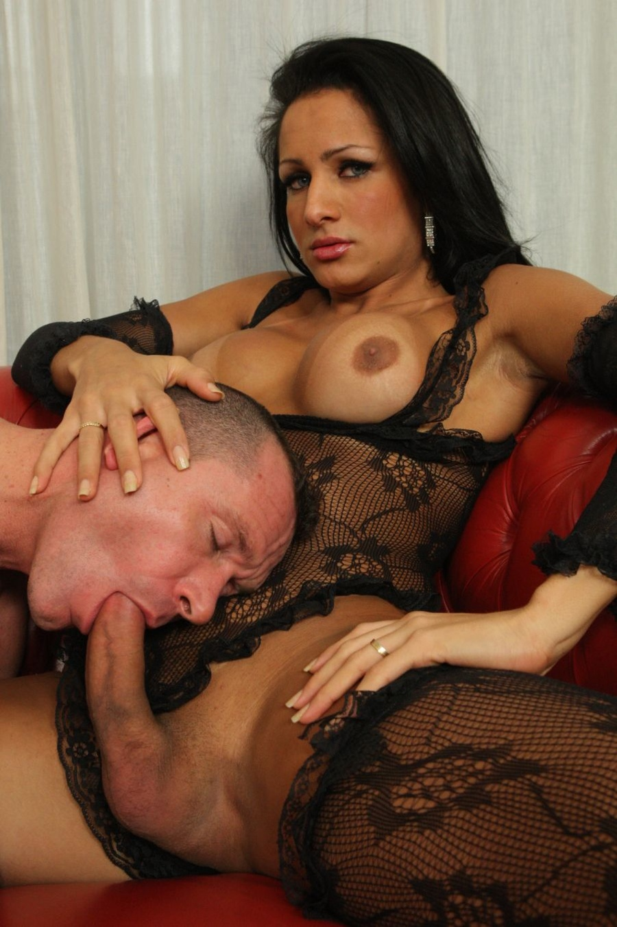 Transvestite foced to suck cock