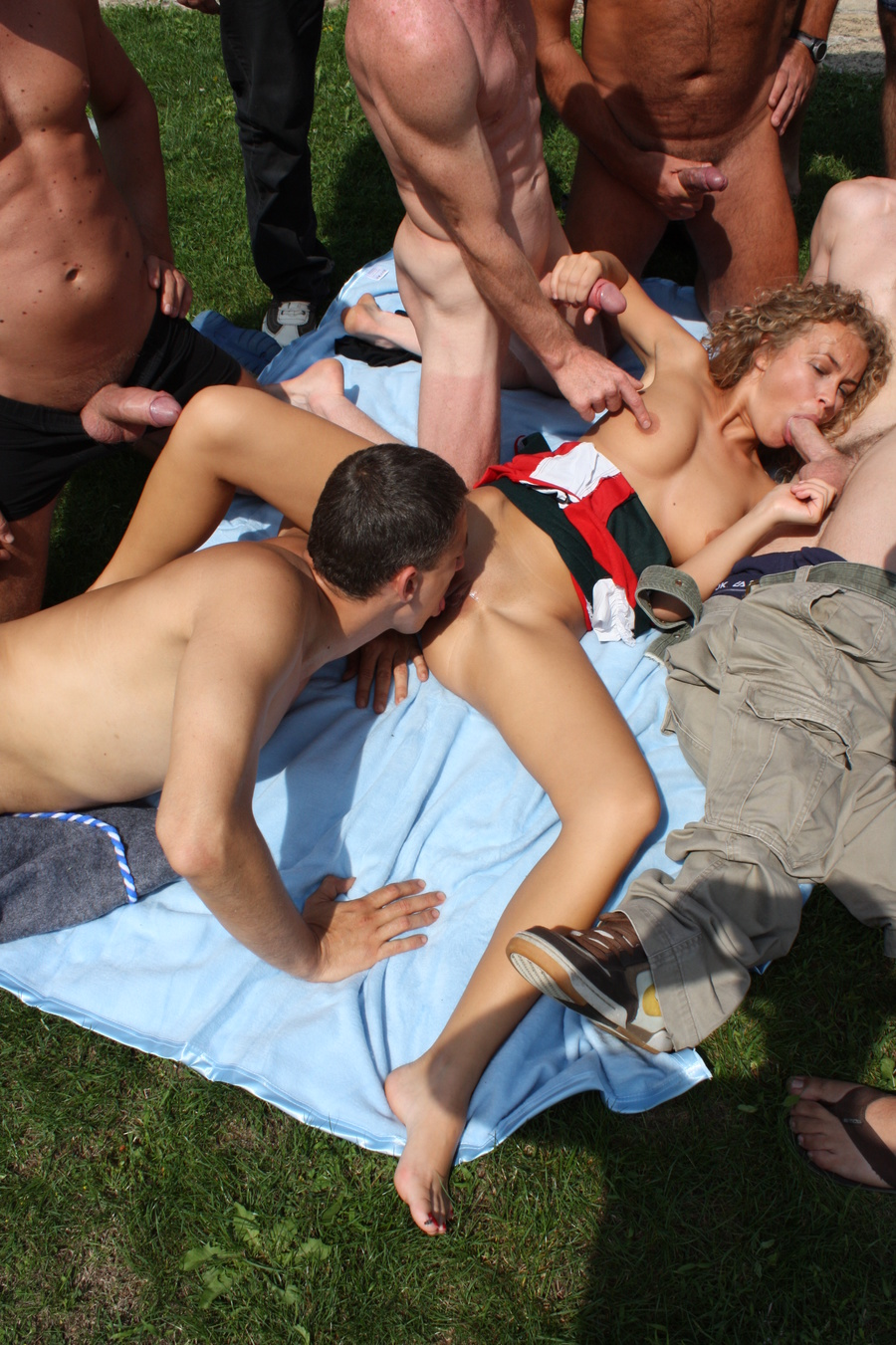 Erotic pictures showing three guys on a girl