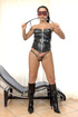 Dominatrix tranny whips stud's ass wearing latex