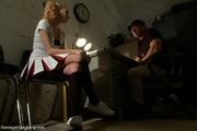 blonde pigtailed cheerleader stretched