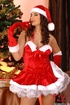 Erotic girl in Santa Claus outfit has fun taking…