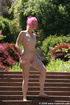 Pink hair lady taking an outdoor stroll in just…