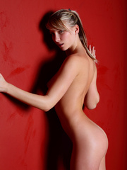 Busty Nicole in ponytail posing on red - XXX Dessert - Picture 4