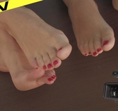 Two hot chicks charm with their beautiful bare soles and red hot toenails