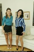 Two sassy babes hike up their short little skirts…