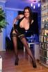 Lovely brunette babe in stockings takes off her…