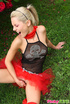 Sexy naughty blonde in pretty red and black dress…