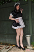 Male crossdresser dressed like innocent sweet girl maid in uniform
