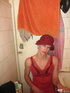 Young crossdresser in red negligee and black…