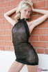 A charming blond in her seethru blacked laced…