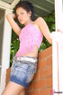 Innocent seductress in denim miniskirt starts…