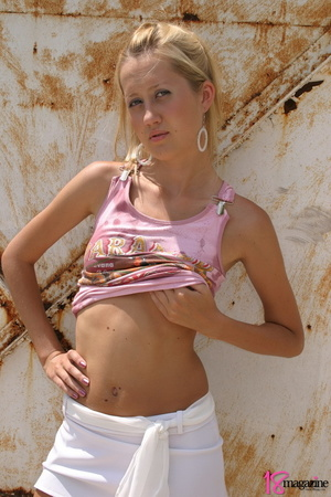 An alluring blond slut was so hot to uncover herself in those pink shirt and white mini - XXXonXXX - Pic 4