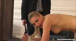 The naked young girl is brought to the torture contraption, is tied up and lashed on her ass by both the man and the woman - XXXonXXX - Pic 3