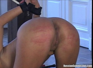 Lovely brunette is seriously being  flogged and whipped hard while her pretty little white ass is raised up for the tormentor - XXXonXXX - Pic 1