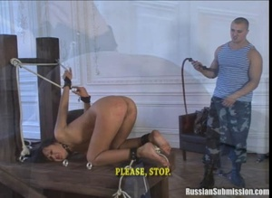 Lovely brunette is seriously being  flogged and whipped hard while her pretty little white ass is raised up for the tormentor - XXXonXXX - Pic 4