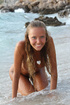 Hot teen Clover posing nude in the ocean wave
