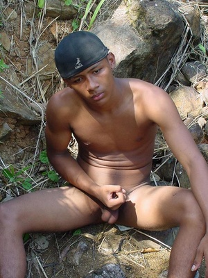 Bronzed, beautiful and horny young latino playing with his awfully large manmeat and blasting cum on himself - Picture 9