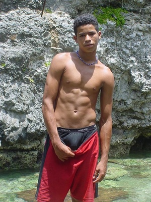 A robust young bronze latino sunbathing among the rocks and wanking that impossibly large dick of his until he cums - Picture 2