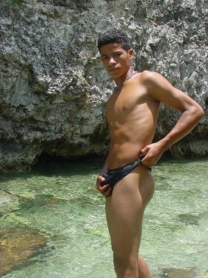 A robust young bronze latino sunbathing among the rocks and wanking that impossibly large dick of his until he cums - XXXonXXX - Pic 9